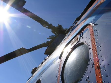 Helicopter MI-8 MT  and the sun rays. Tundra. North of Siberia. Stock Photo
