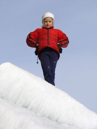 snowscene: Young girl on ice slope Stock Photo