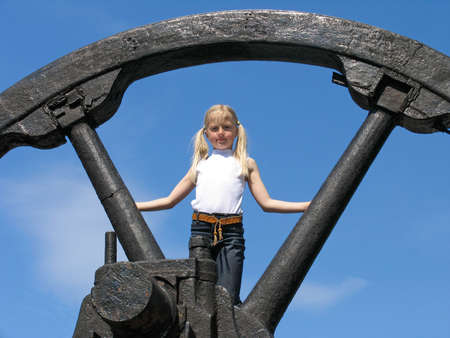 flywheel: Girl in the park of historical engines