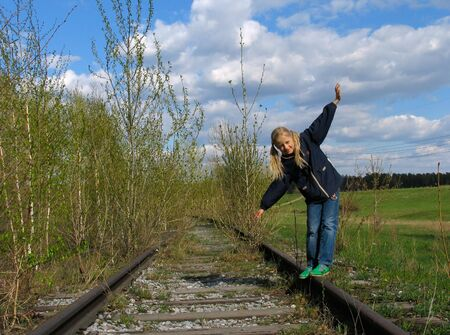 Girl  balancing on rails