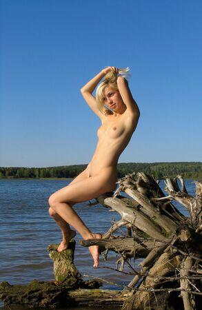 Blonde girl near the river Stock Photo - 259433