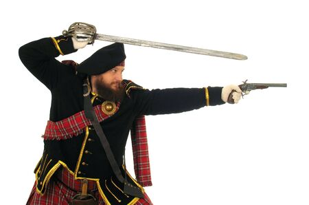 Scottish warrior in the medieval uniform photo