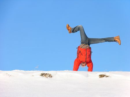 Somersault on the snow under the blue sky Stock Photo - 436750