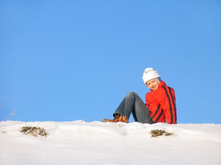 snowscene: Young girl siting on snow Stock Photo