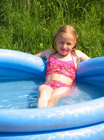 Smiling girl in the swimming-pool photo