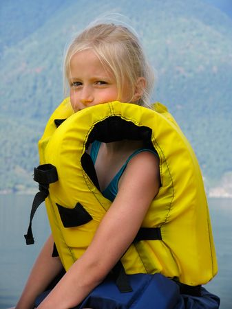 Girl in the yellow air-jacket on Altai lake Teletskoe photo