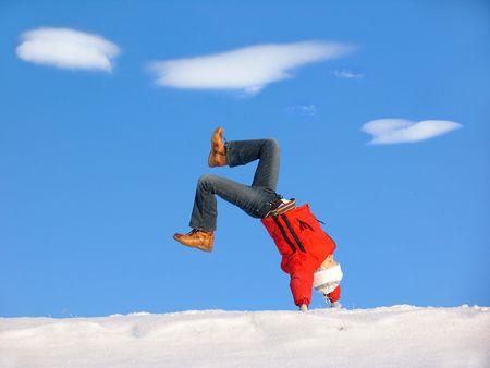 winterday: Cartwheel on the snow under blue sky Stock Photo
