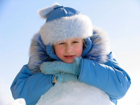 Winter portrait of young girl on blue sky background Stock Photo - 637094