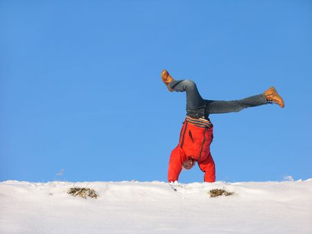 Somersault on the snow under the blue sky Stock Photo - 637089