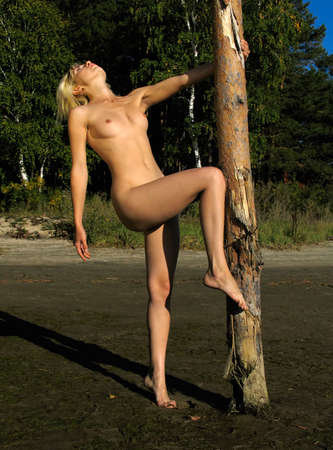 undressed: Nude girl near the post Stock Photo