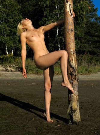 feet naked: Nude girl near the post Stock Photo