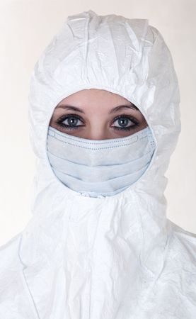 epidemiology: Woman dressed in white operating coat  with mask