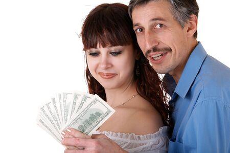 man holding money: Happy family thinking how to spend money Stock Photo