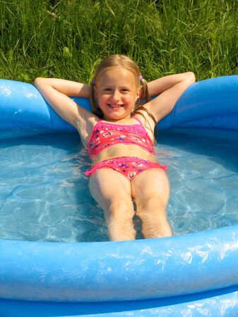Smiling girl in the swimming-pool