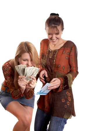 Young pretty girls with envelope and money in hands photo