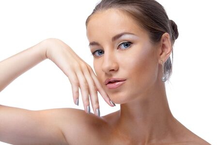 close-up portrait of beautiful blue eyed caucasian model on white