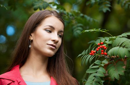 Portrait of beautiful girl looking on ashberry photo