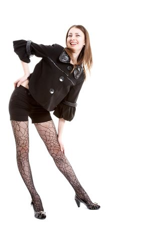 Young female brunette in black stockings on white photo