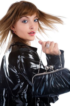 attractive young model in bright black raincoat turns back and her hair flutter photo