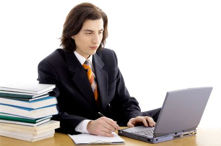 long haired man in suit on white with laptop and books photo