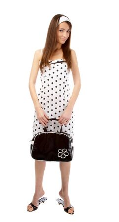 beautiful model poses in polka-dot dress with black bag on white Stock Photo - 4097139