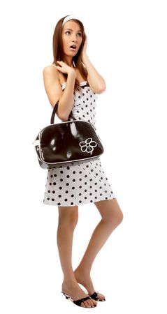 sandal: beautiful model poses in polka-dot dress with black bag looks shocked