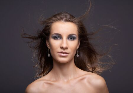 flatter: portrait of attractive young model with flattering hair