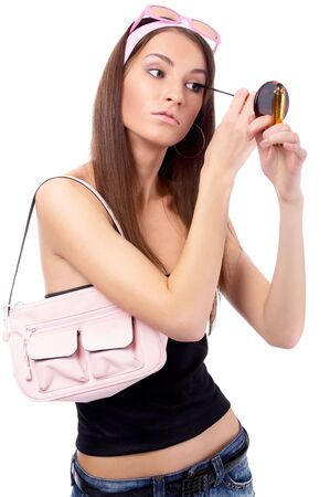 beautiful caucasian brunette does her make-up Stock Photo - 4388127