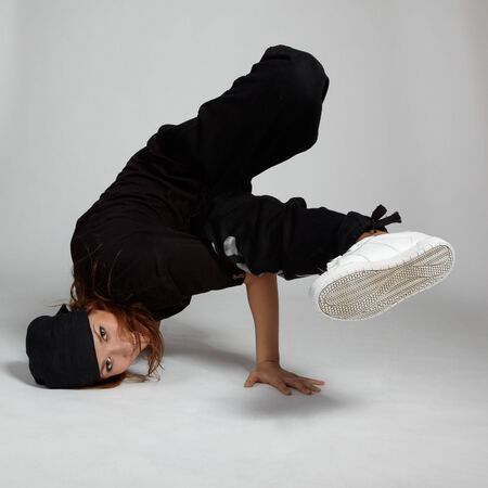portrait of beautiful young breakdancer in black photo