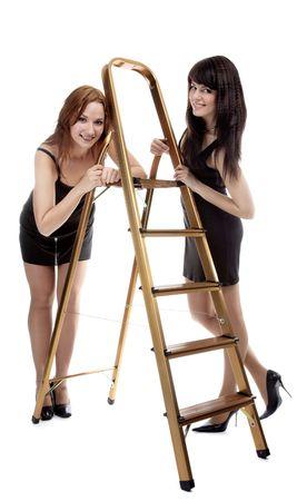 portrait of two beautiful models posing near step-ladder Stock Photo - 4500239