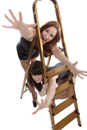 portrait of two beautiful models posing near step-ladder Stock Photo - 4500250