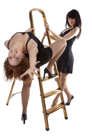 portrait of two beautiful models posing near step-ladder Stock Photo - 4500240