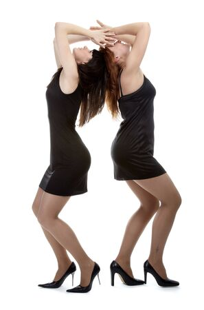 portrait of two beautiful models posing in black dresses Stock Photo - 4500229
