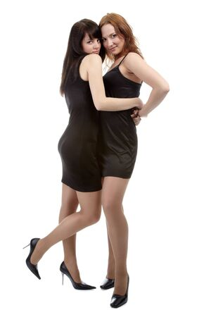portrait of two beautiful models posing in black dresses Stock Photo - 4500226