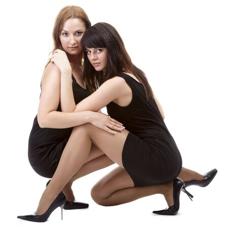 portrait of two beautiful models posing in black dresses Stock Photo - 4500233