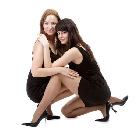 portrait of two beautiful models posing in black dresses Stock Photo - 4500221
