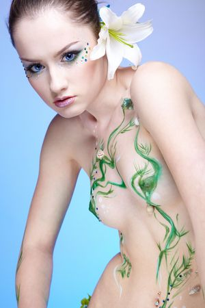 portrait of beautiful girl with mermaid bodyart on blue Stock Photo - 4642467