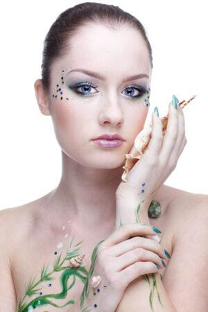 portrait of beautiful girl with mermaid bodyart photo