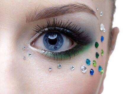 portrait of beautiful girls eye zone with mermaid bodyart photo