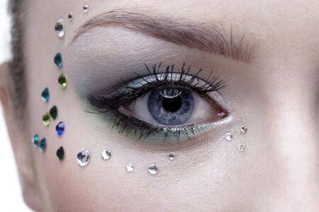 portrait of beautiful girl's eye zone with mermaid bodyart Stock Photo - 4642505