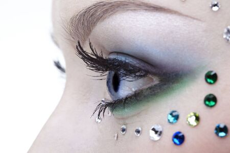 portrait of beautiful girl's eye zone with mermaid bodyart Stock Photo - 4642472