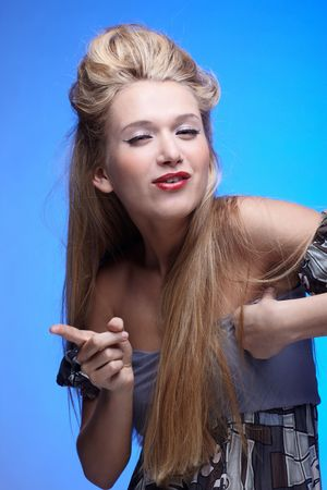 portrait of beautiful european long haired blonde model shaking her finger jokingly photo