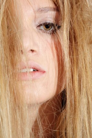 close-up portrait of beautiful european long haired blonde model looking sad and melancholic Stock Photo - 4891937