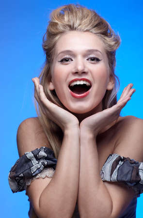 portrait of beautiful surprised happy blonde girl photo