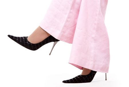 court shoes: Black court shoes and pink trousers on white bakground