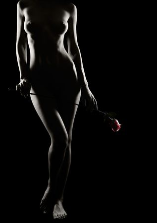 naked lady: Beautiful nude girl with rose in hands Stock Photo