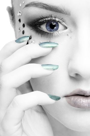 portrait of beautiful girl half-face with mermaid bodyart photo