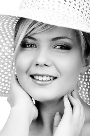 portrait of beautiful slavonic blonde girl with summer white hat with big brims photo