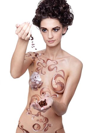 Girl with coffee theme body-art and coffee beans in hands Stock Photo - 5442771