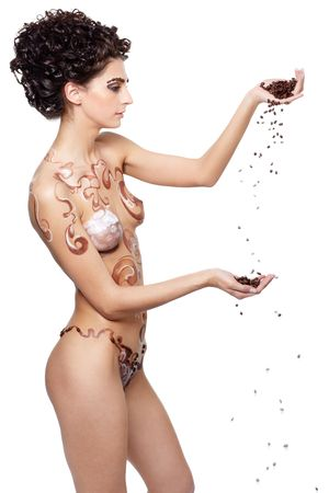 Girl with coffee theme body-art and coffee beans in hands photo